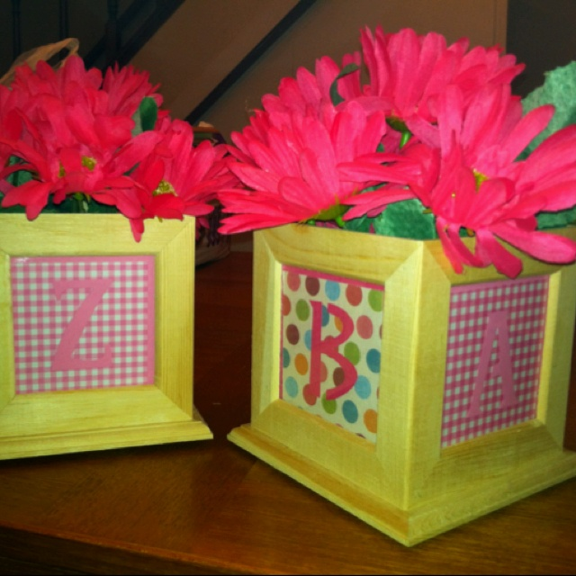 ABC block center pieces for ABC baby shower. Found the wooden picture boxes at Hobby Lobby.