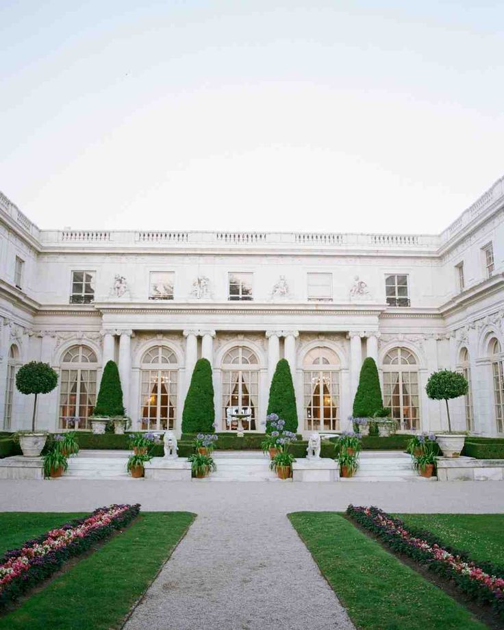 A Timeless New England Wedding at a Newport Mansion | Martha Stewart Weddings - Guests were able to experience old-world New England charm at the Rosecliff Mansion in Newport, Rhode Island. Set along the Atlantic Ocean, this historic mansion was built by architect Stanford White during the Gilded Age and boasts an elegant driveway and expansive lawn.