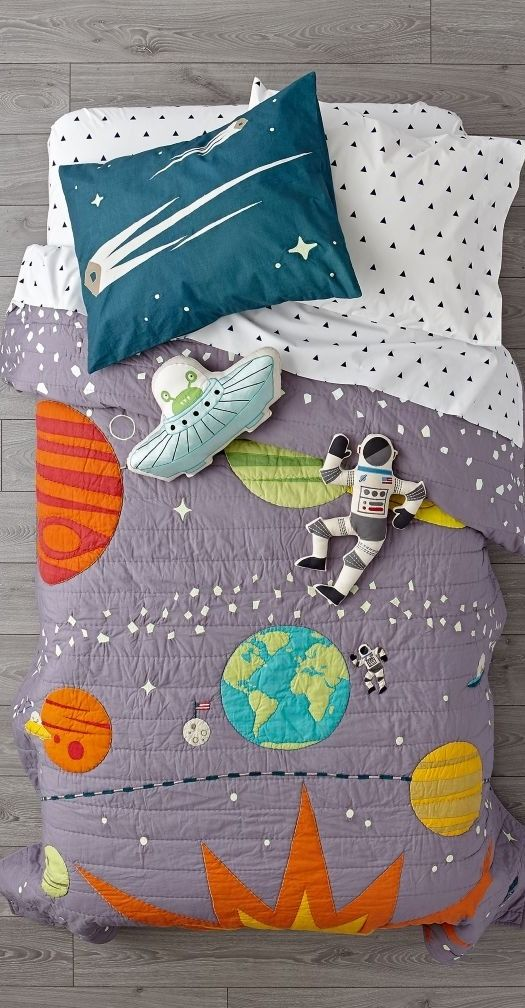Shop Cosmos Glow in the Dark Bedding. Get ready to explore deep space with this galaxy bedding set. The grey quilt features printed and embroidered space-themed elements, while the coordinating sham rounds out the look.