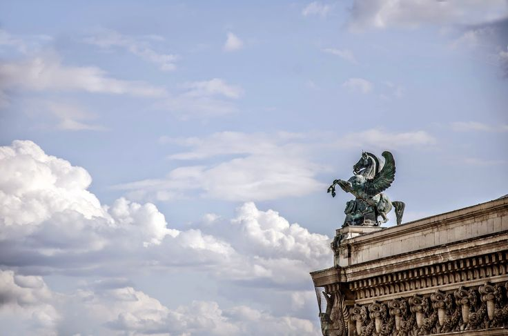 From the rooftop of Les Galeries Lafayette. The statue on the right shows Pegasus, but if you were to see it from the other side (facing the Opera Garnier) you would also see Pheme (Renommée in French), a greek divinity symbolizing fame. Its one of the two sculptures that you can see on both sides of the Garnier opera house. It was made by Eugène-Louis Lequesne