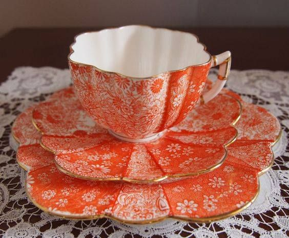 Gorgeous orange teacup with saucer! Full of energy!