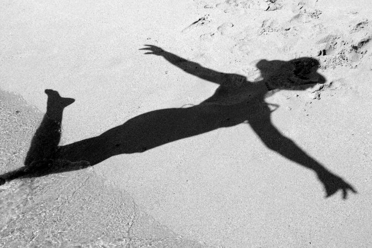 Summer Sun, Shadow of Woman on Beach