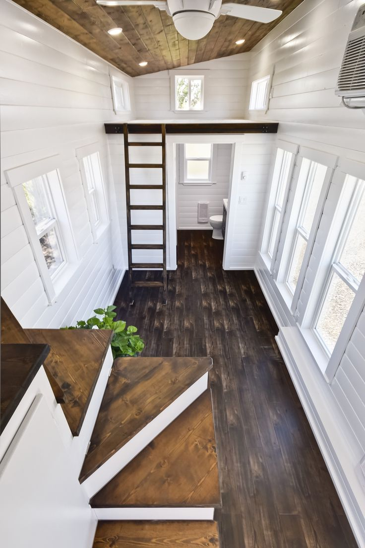 Built by Mint Tiny House Company, this tiny home is a customized version of their Loft Edition. They have added in recessed lighting, engineered wood flooring, interior paint, and a storage staircase!