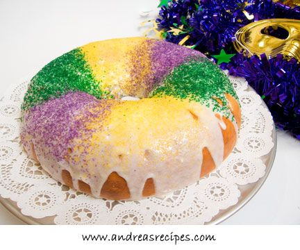 King cakes are a traditional Mardi Gras dessert, and according to legend the royal colors of purple, green and gold on the cake honor the three kings who visited the Christ child on Epiphany. But King Cakes can be made year-round for many festive occasions, such as Christmas, Thanksgiving, weddings, birthdays, etc, just choose the colors of icing and sugars to match the occasion.  There are many possibilities for fillings. You can crumble your favorite candy bars or mix your own concoction w