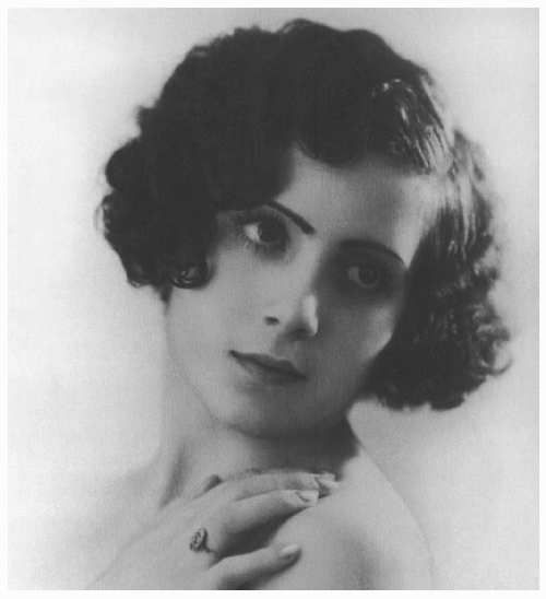 María Eva Duarte in a photographic portrait .   in Buenos Aires, Circa 1935. Eva's father, Juan Duarte, had two families: one with his legal wife, Adela D'Huart, and another with his mistress. María Eva was the fifth child born to the mistress, Juana Ibarguren. Duarte did not hide the fact that he had two families and divided his time between them more or less equally for a time,