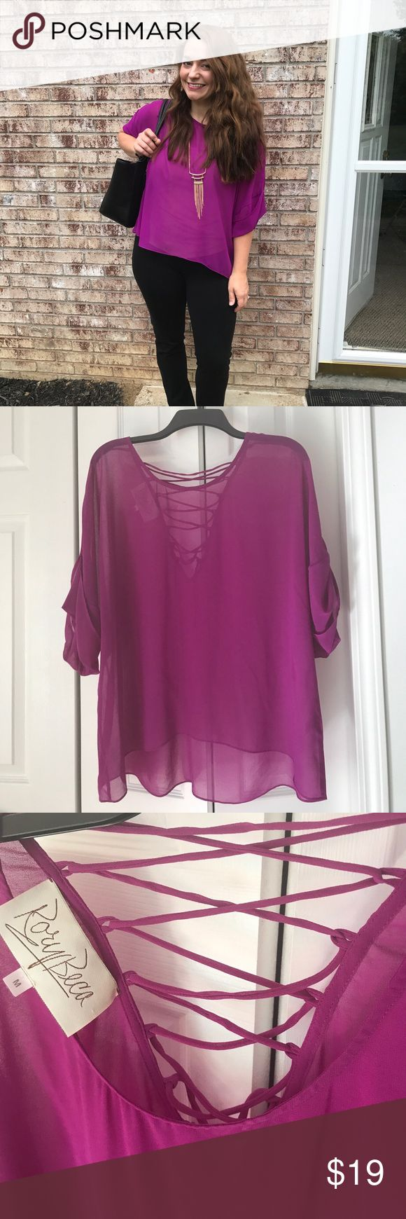 Rory Beca M cross-cross back Fuchsia Blouse Boutique Fuchsia flow with criss-cross tie up back. Fits very loosely and more like a size Large. I've worn with black skinny jeans and black pencil skirt. It's a stunning top. Rory Beca Tops Blouses