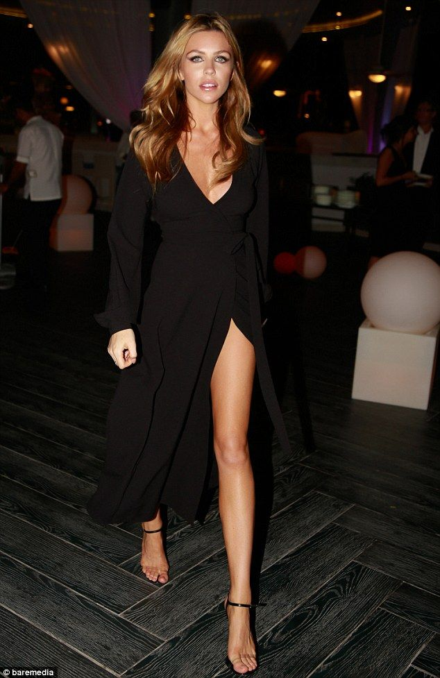 Baby on board: Abbey Clancy showed off her incredible figure in a plunging dress with a da...