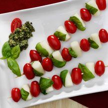 Tomato Mozzarella Skewers from WW.  Also like olive oil, balsamic and lemon juice drizzled over.