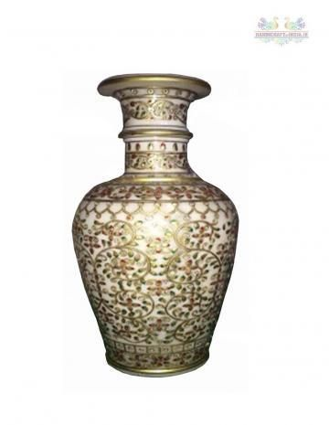Keep flowers inside this beautiful vase and it will change the overall look of your home decor. The vase is in white marble with white, grey and red designs on it. The embossed gold paint vase has kundan and cutwork.