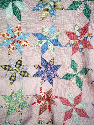 vintage star quilt. I partly like that some of the parts meld into the background.