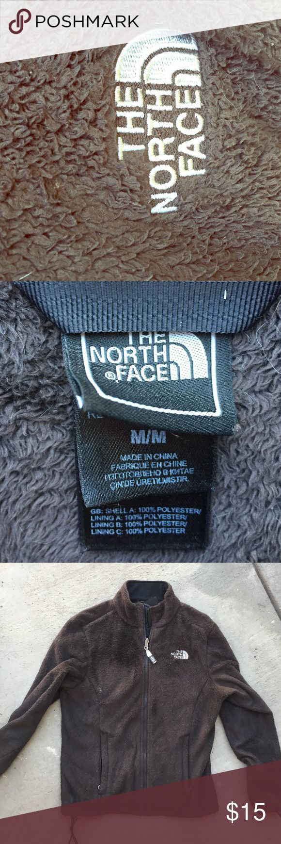 Brown North Face Jacket This is kind of old. One of the black plastic pieces that draws in the waist band is broken but it still works if you like your jacket tighter around the bottom. It's definitely been worn, which is why I'm selling it so cheap North Face Jackets & Coats