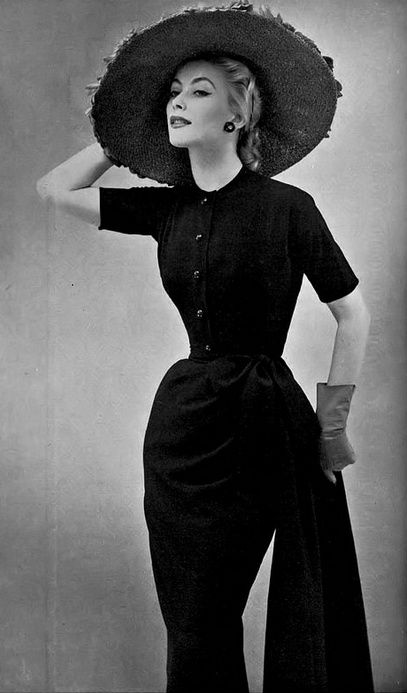 1952 Genevieve in black wool dress, draped and knotted falling in a long sash by Christian Dior