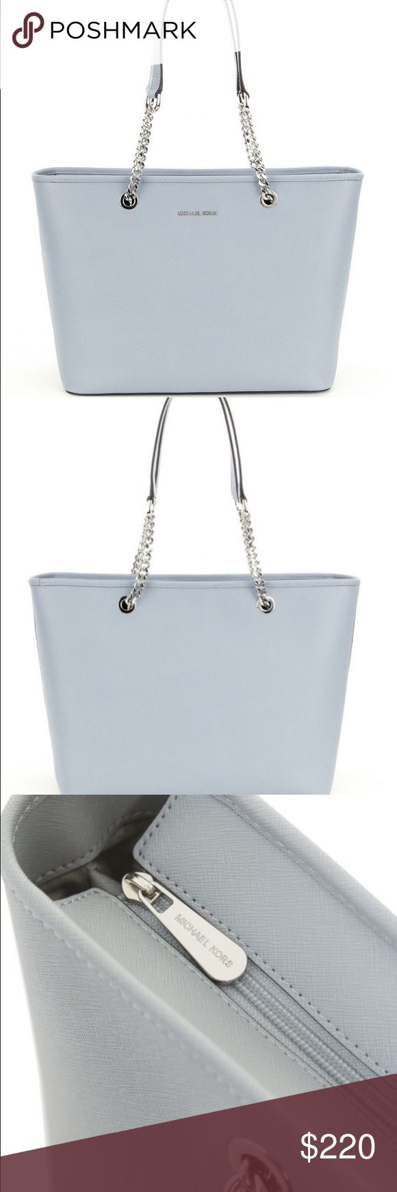 NWT Authentic Michael Kors Jet Set Bag Dusty Blue Beautiful Michael Kors Jet Set Tote bag with silver chains in color Dusty Blue. NWT! Get this bargain before it's gone! Michael Kors Bags Shoulder Bags