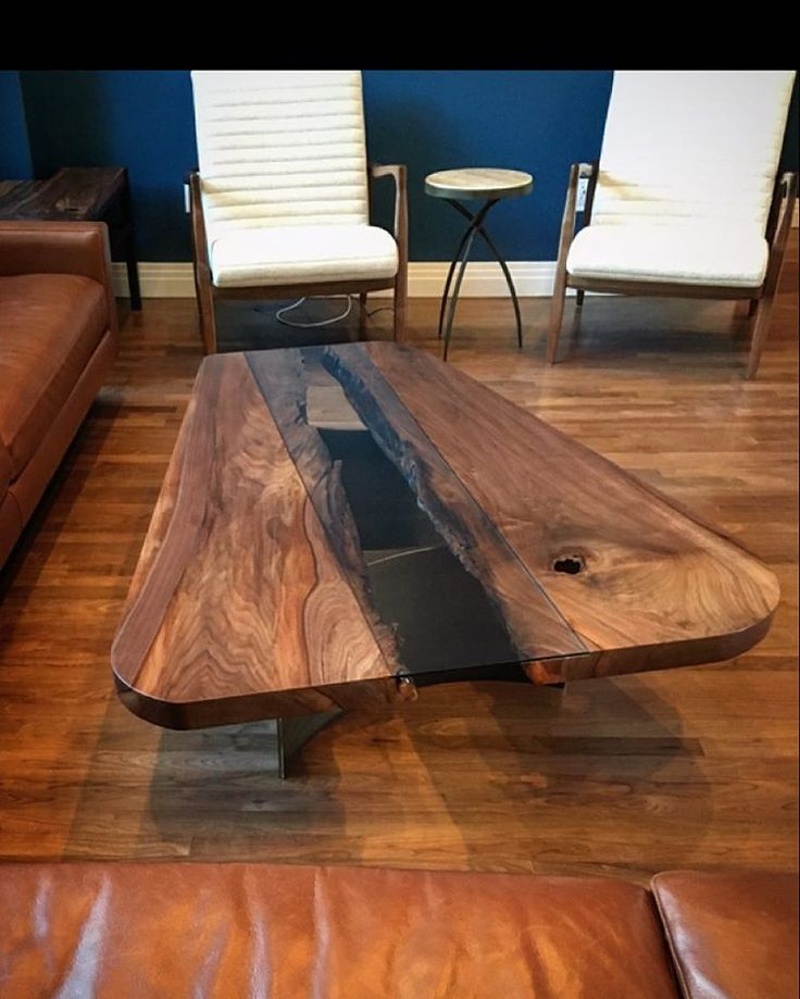 #tgif .... #fresh delivery today. A single #walnut #slab #coffeetable . This tree had a massive bark inclusion...we added rolled plate steel legs and glass. The customer was missing their rug, it would have helped the pic. #wherewoodmeetssteel #interiordesign #attentiontodetail #custom