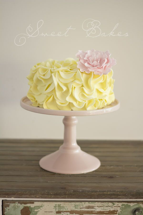 Yellow Ruffle Cake with a handmade Pink Peony!  https://www.facebook.com/sweetbakess