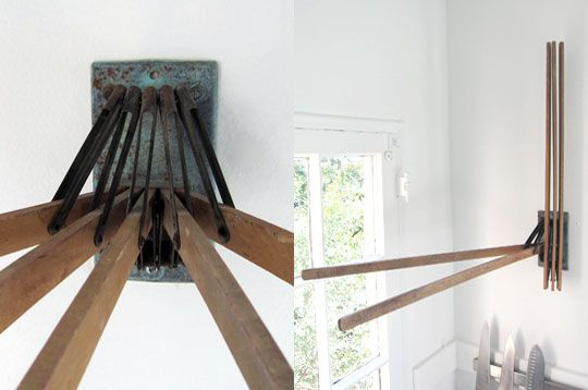 Oooohhh!  I want one!  What a brilliant use of an antique drying rack!