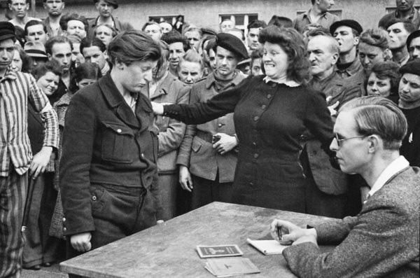 Gestapo informer, Dessau, Germany, 1945.  \\ Henri Cartier-Bresson