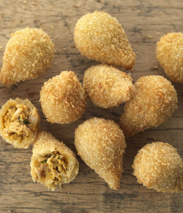 Marcello Tully's coxinha recipe stays true to the Sao Paulo street food classic - mixing shredded chicken breast with cream cheese, coating in a simple batter and breadcrumbs and shaping to resemble chicken drumsticks.
