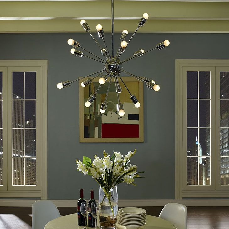 Volley chandelier in silver release an impressive array of 24 beams of light in the volley
