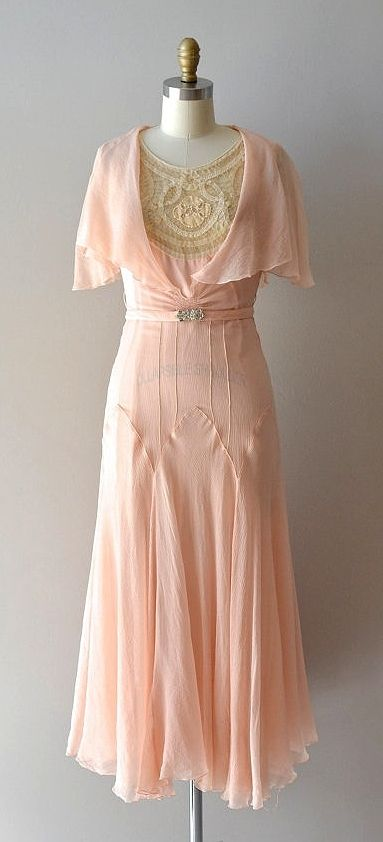 Vintage 1920s; except for the lace bodice (which does cover a plunging neckline), this dress seems ultra-feminine in the era of the flapper.