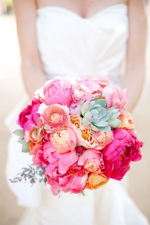 Wedding bouquet of pink and coral (peonies) with mint succulant accents.