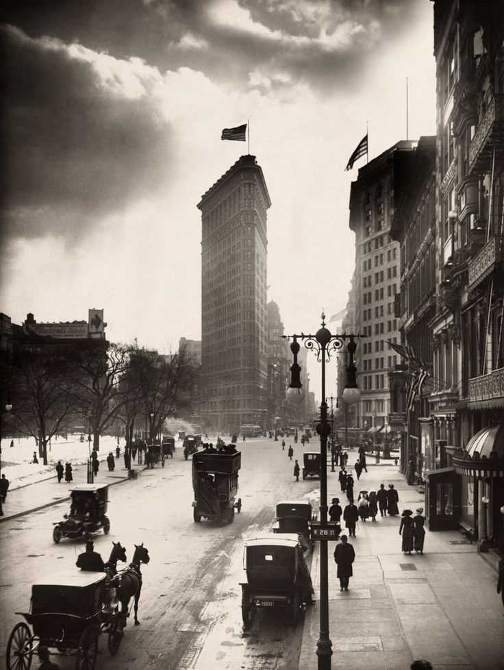 U.S. Locals walk the streets of Madison Square near the Flatiron Building in New York City, 1918 //  W.W. ROCK