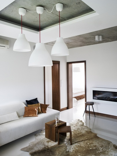 sunken exposed concrete ceiling creates modern statement piece much like plaster ceiling roses