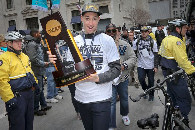 Ryan Arcidiacono with NCAA Championship trophy arriving at Philadelphia City Hall. Villanova University celebrates its basketball championship with a parade through center city Philadelphia on Friday afternoon April 8, 2016. The parade started west of city hall along Market St. and ended at Dilworth Park on the west side of city hall. ALEJANDRO A. ALVAREZ / Staff Photographer