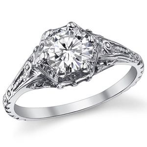 Antique inspired filigree ring with moissanite center and flower motif extending all around the band $565