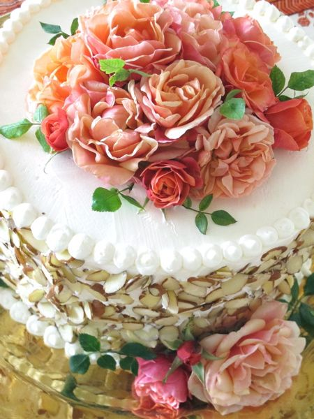 Eddie Ross decadent birthday cake, Italian almondan dgolden rum cake. Decked with fresh flowers. check this out!