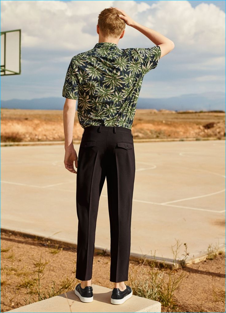 Hawaiian Patterns: Otto-Valter Vainaste models a patterned bowling shirts with darted trousers and basic sneakers from Zara Man.