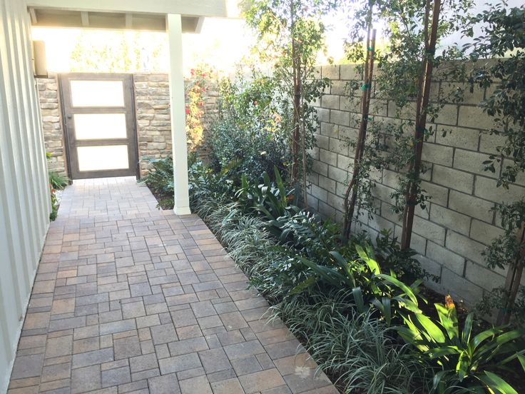 Another view inside the #foyer. Landscaping lines the brink pathway. What do you like about a foyer? #foyerdecor #foyerdesign