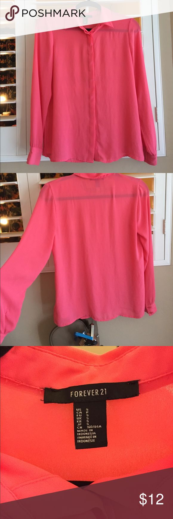 Forever 21 Blouse Hot pink blouse from forever 21. Hidden buttons down the front, collar, and buttons at the wrist. Cute to wear on its own or under something (see last pic :)) size small, but definitely  could fit a medium. Its very flowy and would probably suit a medium better. Perfect condition Forever 21 Tops Blouses