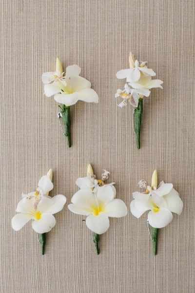 Tropical boutonnieres | Lush Tropical Destination Wedding In Fiji | Photograph by Hilary Cam Photography  http://www.storyboardwedding.com/lush-tropical-destination-wedding-at-intercontinental-hotel-fiji/