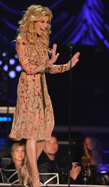 Faith Hill makes a special presentation for Taylor Swift onstage during the 2011 CMT Artists of the Year celebration.  Photo Credit: Rick Diamond/Getty Images