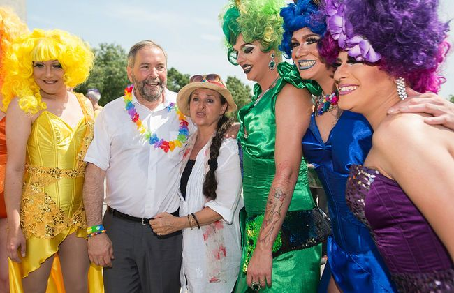 Tom and Catherine Mulcair pose alongside participants of Montreal's 2015 Pride Parade on Aug. 16.