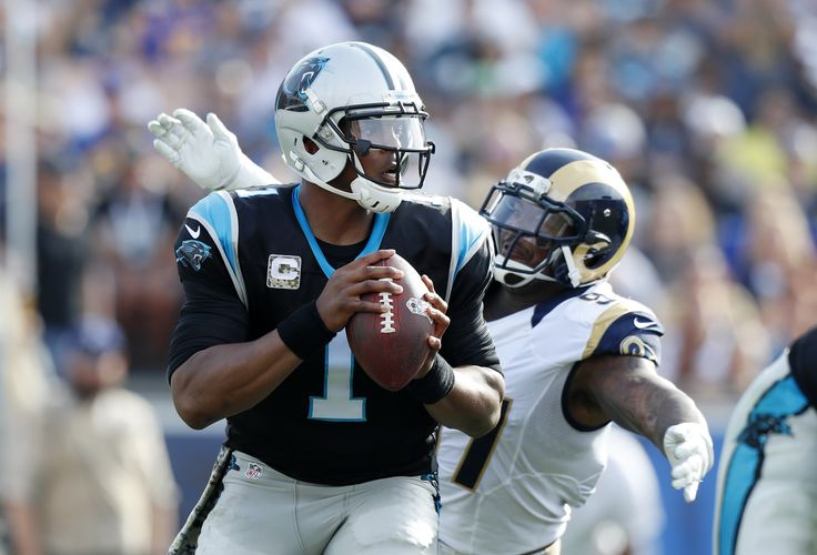 Newton sacked 5 times, still leads Panthers past Rams 13-10