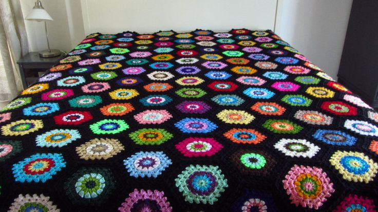Why not brighten up your bedroom with this colorful crochet bedspread?