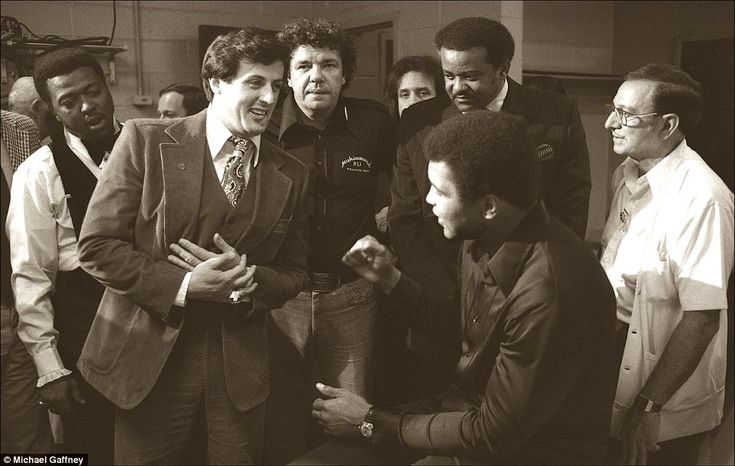 In the locker room with Sylvester Stallone before the Earnie Shavers fight, Madison Square Garden, New York City, 1977. Sylvester Stallone, the actor who wrote and starred in the movie 'Rocky', inspired by the Muhammad Ali-Chuck Wepner fight, meets with the Champ to wish him luck