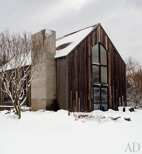 We love this renovated barn! The floor to ceiling window adds a modern feature and takes advantage of the amazing view!