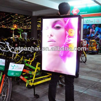 Walking mobile billboard, internal LED illuminated backlighting - up to 5 hours of Battery Life   Model: JNDX-1-S(D)      Color in black , one static poster, 5hrs battery        Features:   Light and comfortable to carry.   01-Sided backlit units that can be used night or day   Battery life lasts for 5-08 hours, price is different, standard battery is 5hrs only, contact us if need 08hrs billboards.