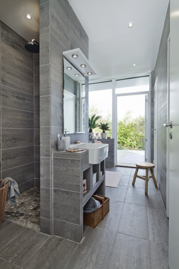 love the gray tiles and river rock detail!