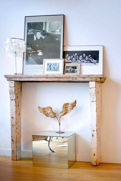 Fire surround, mirrored cube and angels wings with vintage 50's table lamp Image by Andrew Snow Photography from Houzz