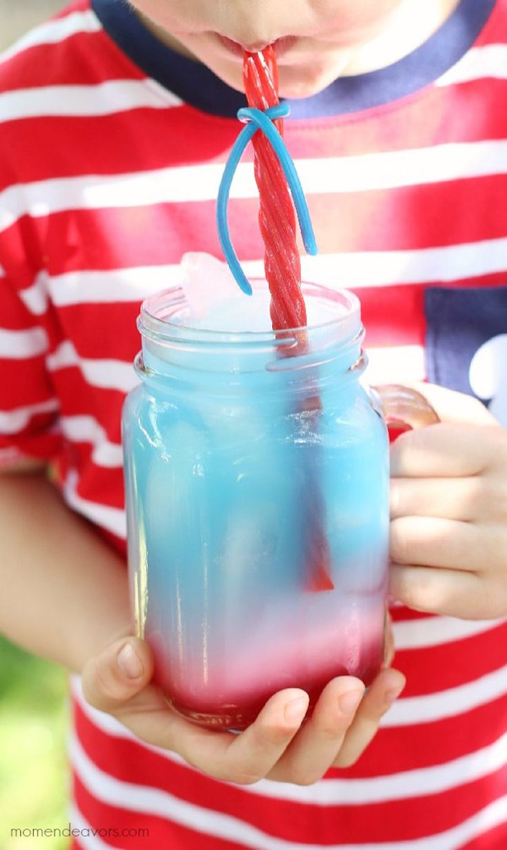 Red, White, and Blue punch with a Twizzlers straw. My kids are going to love this 4th of July treat!