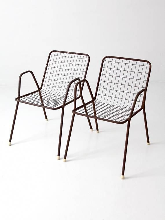 8f26da8551b0 This is a set of two mid-century patio chairs. The brown metal frame  chairs  feature a wire metal seat and back. Sleek modern shape for your outdoor  living.