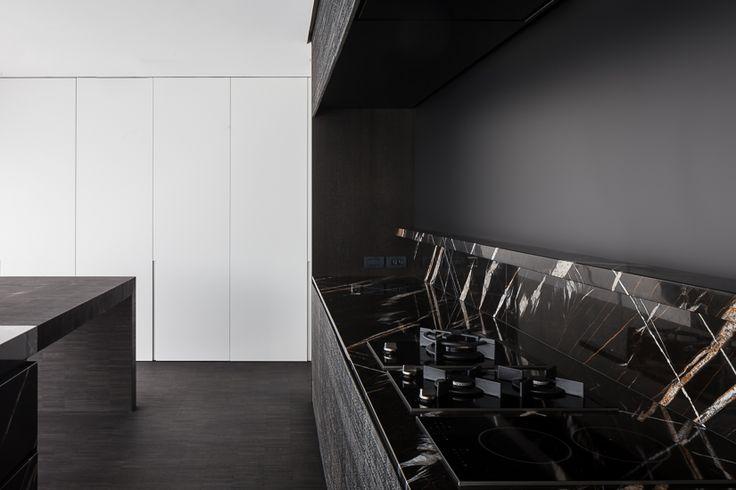 Kitchen in black Sahara Noir stone by Vanden Weghe.