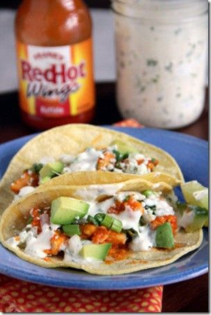 Buffalo Chicken Tacos    Ingredients:  1 pound chicken breasts, skinless, boneless, cut into 1 inch pieces  ⅓ cup flour  3 tablespoon cornstarch  ⅛ teaspoon cayenne pepper  1 teaspoon garlic powder  ⅓ cup buffalo wing sauce (Frank's Buffalo Wing) , plus extra for garnishment  1 Tablespoon olive oil  10 6-inch yellow corn tortillas  Toppings