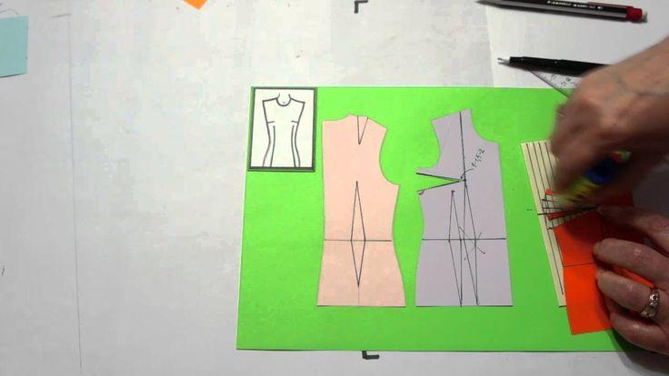 Оформление нагрудной вытачки на ткани в полоску