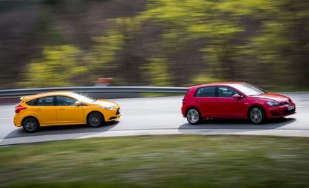 2015 Volkswagen GTI vs. 2013 Ford Focus ST -  British the F-type may be, but it's designed to resonate in the former colonies, from the U.S. to Hong Kong.  Comparison Tests
