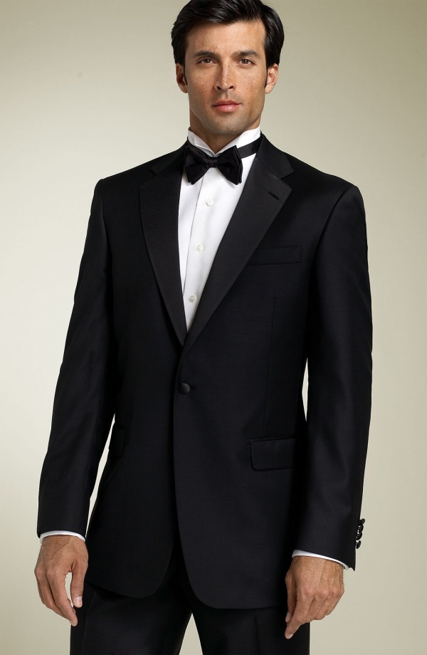 Father of the bride tux. It's different then what the groom and groomsmen will be wearing.